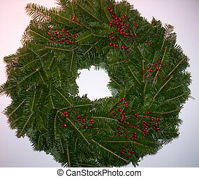 christmas wreath on white background with red berries