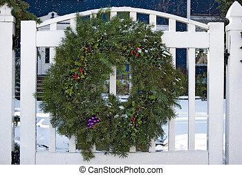 Christmas wreath on white gate