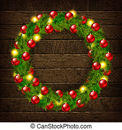Christmas wreath on wooden background.