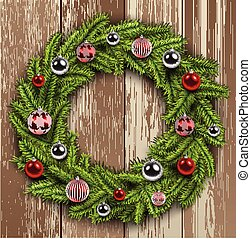 Christmas wreath on wooden board background