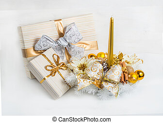 Christmas wreath with a gift box for decoration on the eve of Christmas and New Year