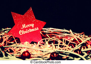 christmas wreath with big red star with greeting. photo