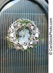 christmas wreath with decorations on a door