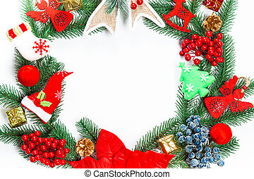 Christmas wreath with decorations, branch of Xmas tree on...