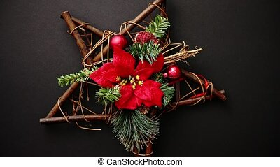 Christmas wreath with dry twigs, pine branches, red balls...