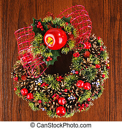 Christmas wreath with red and gold bauble decorations