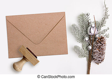 Christmas, Xmas rubber stamp and kraft envelope. Mockup for winter holiday products
