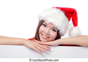 christmas young girl showing blank billboard