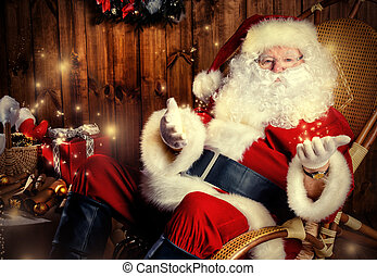 christmastime - Good old Santa Claus with Christmas gifts at...