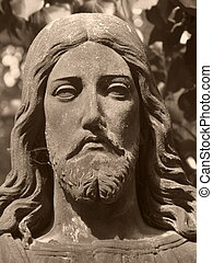 Christus face on grave in old abadoned cemetary, Detail of statue