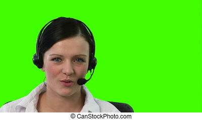 Chroma Key footage of a woman on a Headset