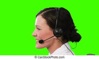 Chroma Key footage of a woman on a Headset