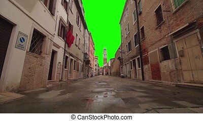 Chroma key instead of the sky in the street of the ancient...