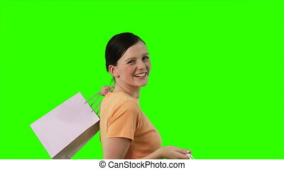 Chroma - Key Shopping - Green Screen of a joyful woman with...