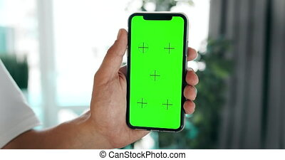 Chromakey Smartphone in Hands Indoors - Male hand holding...