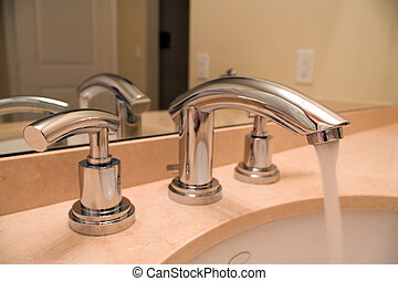 Chrome faucet in luxury bathroom