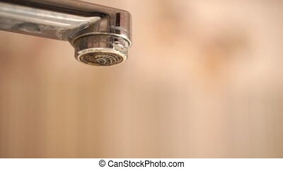 Chrome faucet with running water slows to a drip - Faucet...
