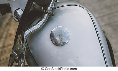 chrome-plated vintage motorcycle standing at the show . motorcycle culture and speed. Separate details of a collection motorcycle of silver color close-up