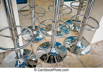 closeup detail of chrome stands inside a store