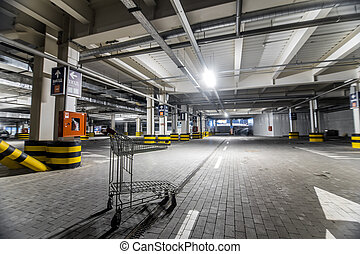 Chrome store trolley at underground parking with illuminated background