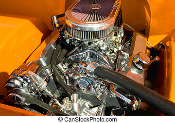 powerful hot-rod engine bay with a large number of chromed parts