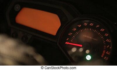 chromed motorcycle speedometer