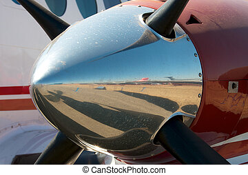 Chromed nose of a propeller engine - Close up showing a...