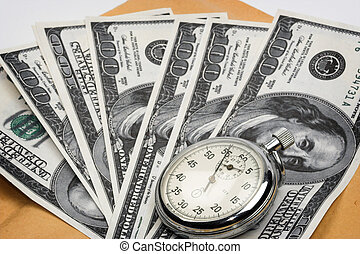 Chronometer and dollar bills close up