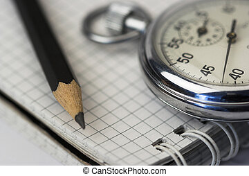 chronometer and pen - chronometer and black pen over ...