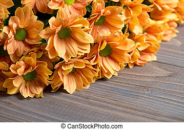 chrysanthemums bouquet on wooden background.