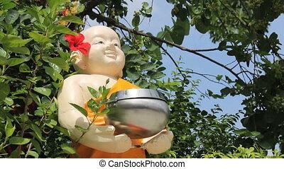 Chubby Buddhist Statue Holding Bowl - A chubby Buddhist...