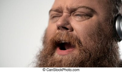 Chubby man singing with aspiration - Passionate male plump...