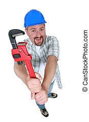 Chubby plumber holding adjustable wrench