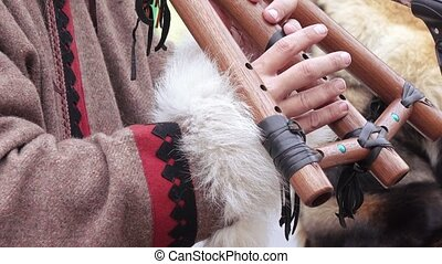 Chukchi musical instrument - Playing the Chukchi musical...