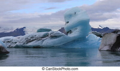 Chunk of ice floating in glacial lake Jokulsarlon, Iceland