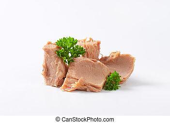 canned tuna - chunks of canned tuna on white background