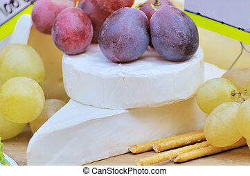 Chunks of cheese with grapes