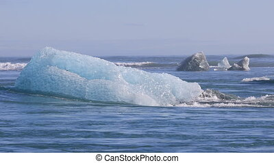 Chunks of ice drifting out to the North Atlantic Ocean near...