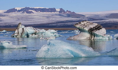 Chunks of ice floating in glacial lake Jokulsarlon, Iceland...