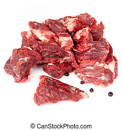 Chunks Of Raw Beef - Chunks of raw beef with juniper seeds,...