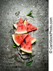 Chunks of watermelon with mint branches.