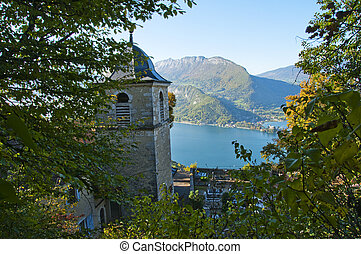 Church and Annecy lake in Savoy, France - Ermitage Saint...