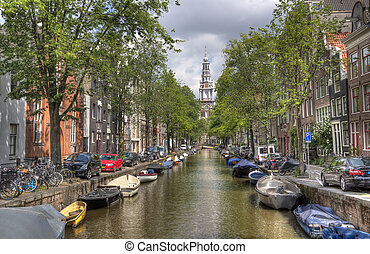 Church and canal in Amsterdam - Tower of the Old Church at...