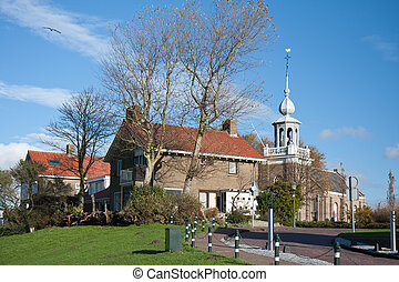Church and houses of an old Dutch fishing village