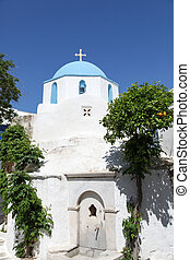 Church and orange tree on Paros island in the Cylcades...