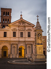 Church and Roman ruins at sunset in Rome