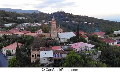 Church and tower preside over quaint and picturesque town of...