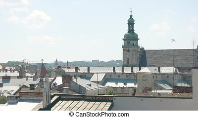 Church and town rooftops. Sunny day in Lviv.