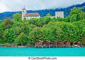 Church at Lake Brienz and Brienzer Rothorn mountain Bern...