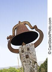 Church bell against a blue sky
